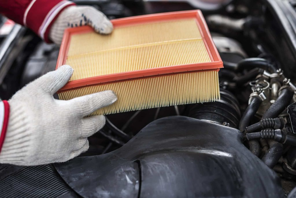 The Auto Mechanic Replaces The Car's Air Filter.