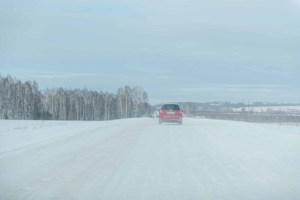 The Car Goes On A Winter Road. Snowy Road. The Road Through The